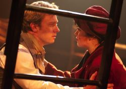 Marius (Jeffrey S. Shankle) pleads with Eponine (MaryKate Brouillet) to leave the barricade for safety and deliver a letter to Cosette